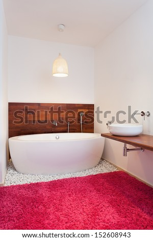 Bath in exotic spacious bathroom in exotic style - stock photo
