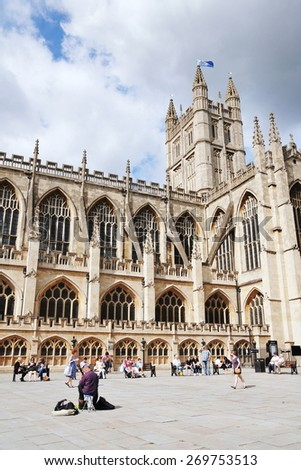 BATH - JUL 26: Tourists and locals gather in the courtyard of Bath Abbey on Jul 26, 2010 in Bath, UK. Bath is a UNESCO world heritage city and popular travel destination with over 4mn visitors a year. - stock photo