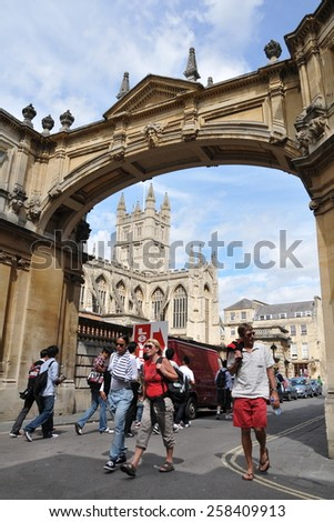 BATH - JULY 26: Tourists and locals walk in the streets surrounding Bath Abbey and Roman Baths on July 26, 2010 in Bath, UK. Bath is a UNESCO World Heritage city, with over 4 million visitors a year. - stock photo