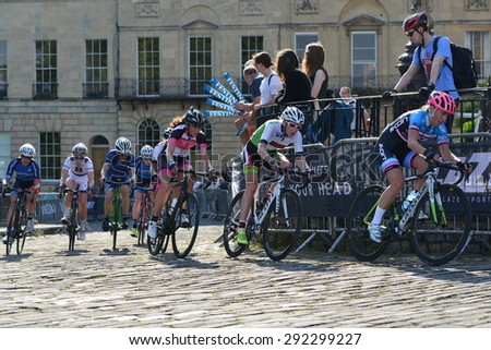 BATH - JUN 11: The peleton rides in the Pearl Izumi Tour Series bicycle race final on Jun 11, 2015 in Bath, UK. The event drew thousands of spectators to the streets of the picturesque Somerset city. - stock photo