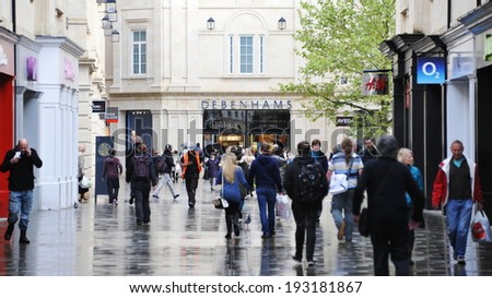 BATH - MAY 1: Shoppers walk through the newly opened Southgate commercial district on May 1, 2014 in Bath, UK. With 37,000 sq metre of retail space Southgate is home to over 50 shops and outlets. - stock photo