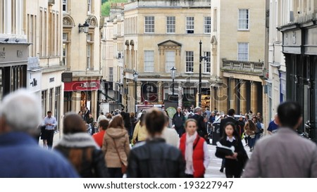BATH - MAY 1: Unidentified people walk along a busy street on May 1, 2014 in Bath, UK. Bath is a UNESCO World Heritage city and popular travel destination with over 3.8 million visitors per year. - stock photo