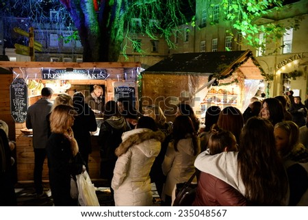 BATH - NOV 30: People visit the Christmas Market in the streets surrounding Bath Abbey on Nov 30, 2014 in Bath, UK. The market has become an annual fixture for the historic Unesco World Heritage City. - stock photo