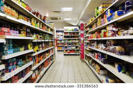 BATH - OCT 20: Aisle view of a Tesco supermarket store on Oct 20, 2015 in Bath, UK. Tesco is the world's second largest retailer with 7,817 stores worldwide and a revenue of £62.3 billion in 2015. - stock photo