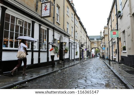 BATH - OCT 5: View of an old cobble street in the city centre on Oct 5, 2012 in Bath, UK. Bath is one of the UK's top tourist destinations with 4.65 million visitors in 2011. - stock photo