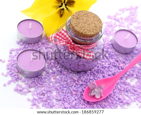 bath salt, candles and yellow flower - stock photo
