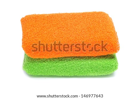bath sponges of different colors on a white background - stock photo