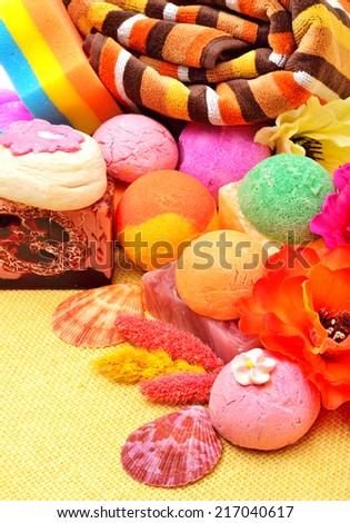 Bath towels, natural soap, bath bombs, sponge - stock photo