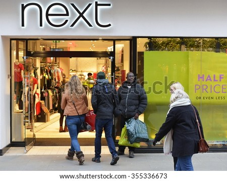 BATH, UK - DEC 26, 2014: People visit stores in Southgate shopping district for the Boxing Day Sales. Many stores across the country traditionally hold sales on Boxing Day with have discounted goods. - stock photo