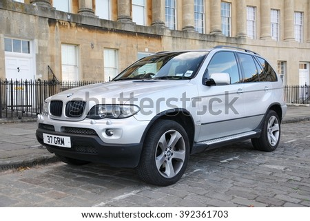 BATH, UK - JUL 26, 2010: View of a BMW X5 3.0i parked on the landmark Royal Crescent. The X5 is a mid-sized luxury SUV manufactured by BMW from 1999 to the present day. - stock photo