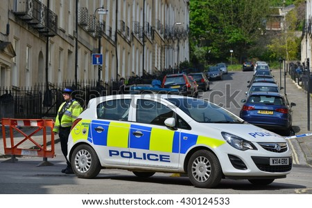 Bath, UK - May 13, 2016: Police stands guard at a roadblock in the vicinity of an unexploded WWII bomb uncovered at a construction site. Thousands of residents were evacuated after the discovery. - stock photo