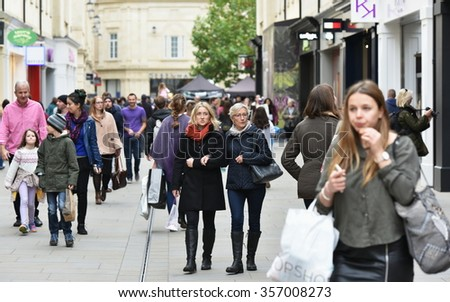 BATH, UK - OCT 18, 2015: People walk on a busy street in Southgate shopping district. The landmark Somerset city has UNESCO World Heritage status and over 4 million visitors a year. - stock photo