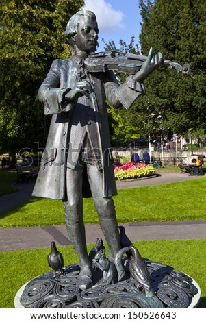 BATH, UK - 29TH SEPTEMBER 2012: Young Mozart statue located in Parade Gardens. in Bath, Somerset. - stock photo