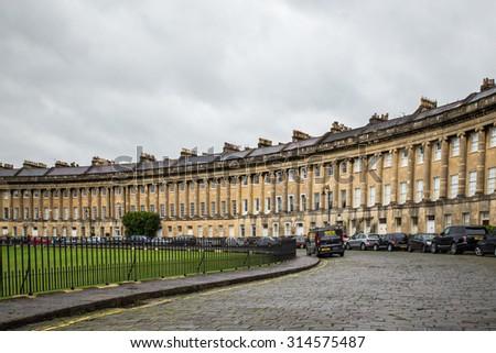 BATH, UNITED KINGDOM - OCTOBER 13, 2014:  View of landmark Royal Crescent in Bath under cloudy skies.  - stock photo