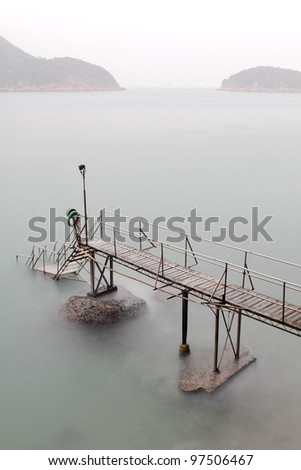 Bathing pavilion is a structure for bathing and swimming at a sea shore. The structure extended from shore into the sea with a large platform. Now, it is a history buildings in hong kong. - stock photo