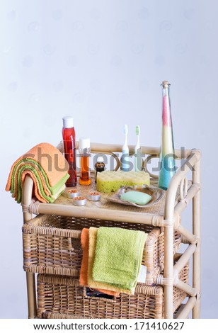 Bathroom accessories on bamboo shelf with baskets - stock photo