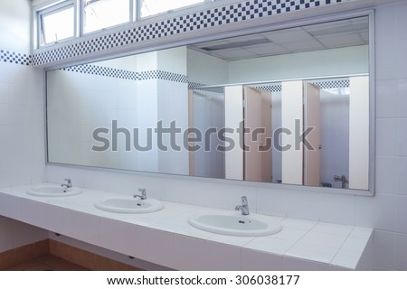 Bathroom at office.Handbasin and mirror in toilet - stock photo