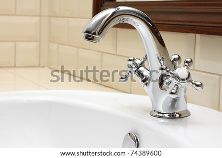 Bathroom close-up - sink and faucet - stock photo