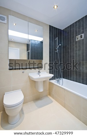 Bathroom detail with toilet, sink and bath tub - stock photo