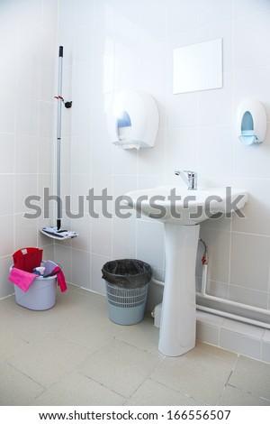 bathroom equipment in the light white bathroom  - stock photo