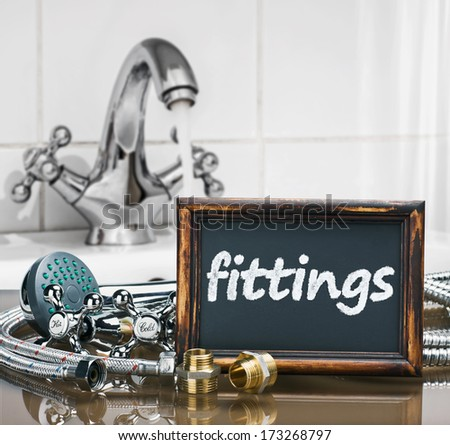 bathroom fixtures and fittings are of different construction and blackboard  - stock photo