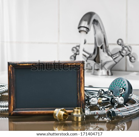 bathroom fixtures and fittings are of different construction and blackboard for text - stock photo