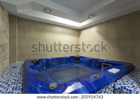 Bathroom interior with jacuzzi - stock photo