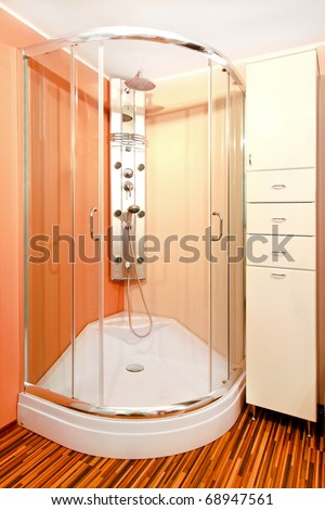 Bathroom interior with shower cabin and hydro jets - stock photo