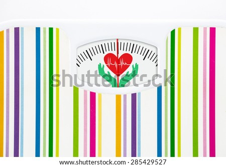 Bathroom scale with heart on dial with lines no numbers - stock photo