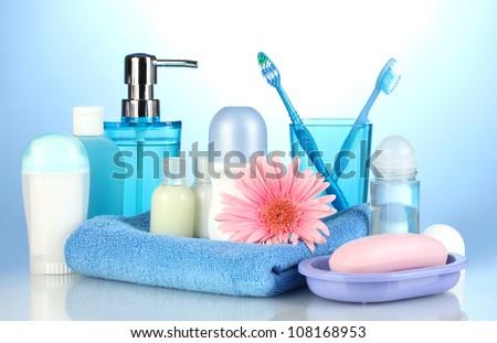 bathroom setting on blue background - stock photo