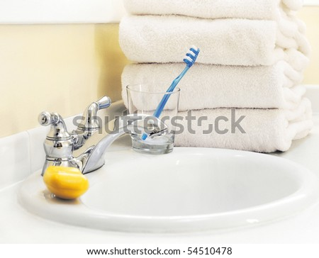 bathroom sink and towels - stock photo