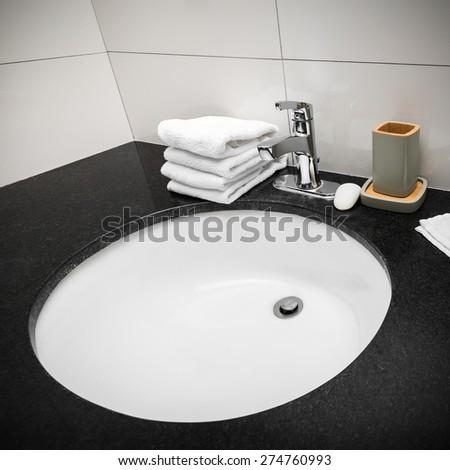 Bathroom sink at restroom hotel interior - stock photo