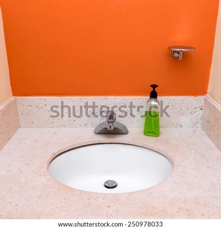 Bathroom sink at restroom interior  - stock photo