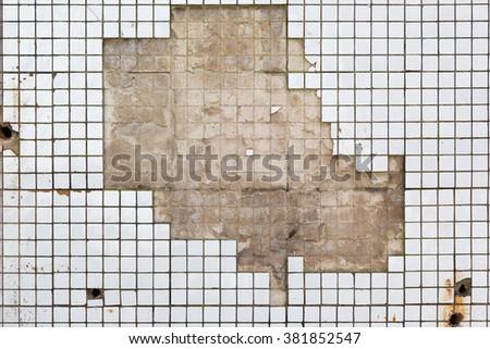 Bathroom wall tiles texture of old demolished house - stock photo