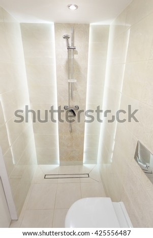 bathroom with shower and toilet, modern bathroom, bright interior, equipped bathroom in the house, a small and cozy bathroom, shower with LED light - stock photo