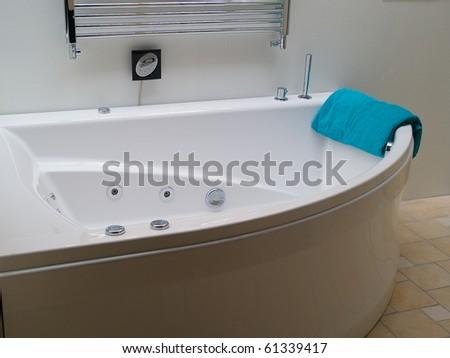 Bathtub jacuzzi in a modern trendy clean design white batroom - stock photo