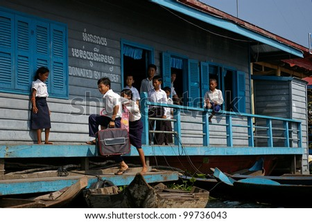 BATTAMBANG, CAMBODIA - NOV 16: Unidentified school children at a school built by the charity UNICEF, November 16, 2006, Battambang, Cambodia. Cambodia is heavily dependent on foreign aid and NGO work. - stock photo