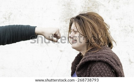 Battered and beaten woman, detail of abuse and violence - stock photo