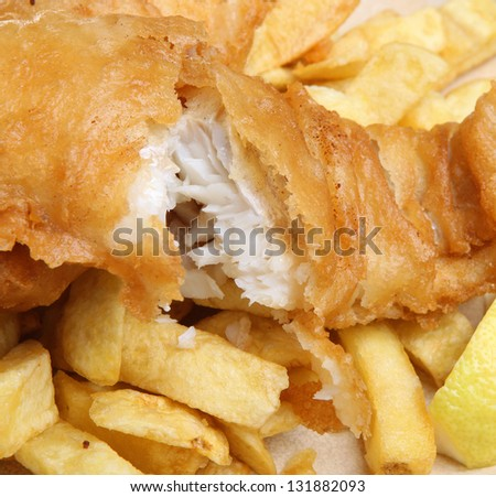 Battered cod fish fillet and chunky chips. - stock photo