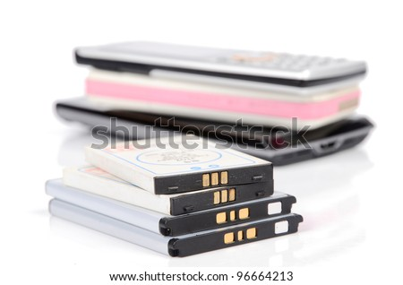 Battery and cellphone - stock photo