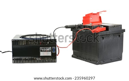 battery and charger isolated on white - stock photo