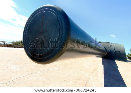 battery of coastal artillery of a powerful cannon in impressive perspective - stock photo