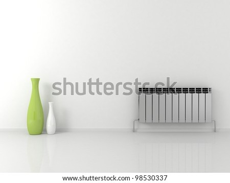 Battery on a white wall - stock photo