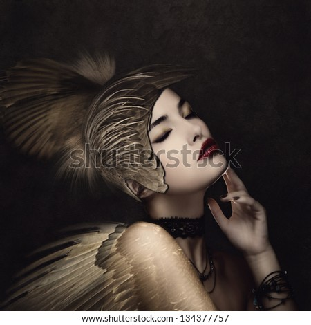 battle angel with feather helmet in calm thinking pose small amount of grain added - stock photo