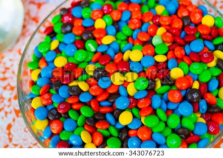 BATTLE GROUND, WA - JULY 19, 2014: Candy bar at a wedding reception featuring m&m candies. - stock photo