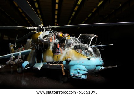 Battle helicopter in hangar (scale-model 1:24 scale). Marking is fictive. Close up with shallow DOF. - stock photo