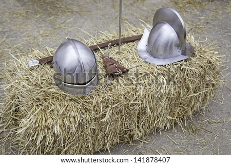 Battle Medieval Helmets, detail of some ancient war helmets, detail of conflict - stock photo