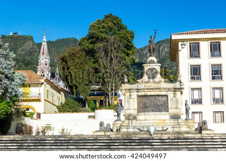Battle of Ayacucho monument in downtown Bogota, Colombia with the striped El Carmen church in the background - stock photo