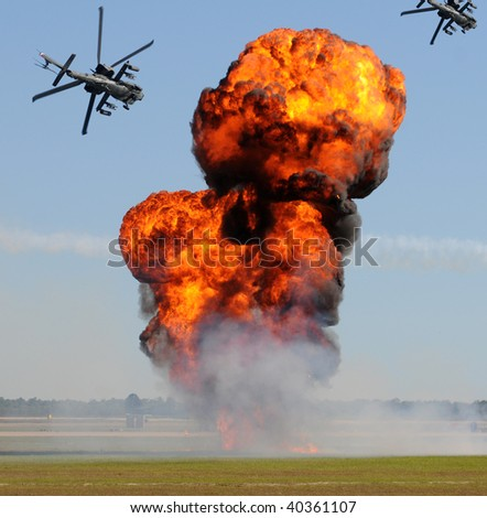 Battle with explosions and helicopter gunships - stock photo