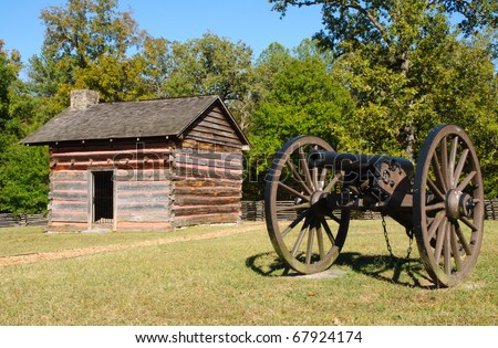 battlefield cabin and cannon - stock photo